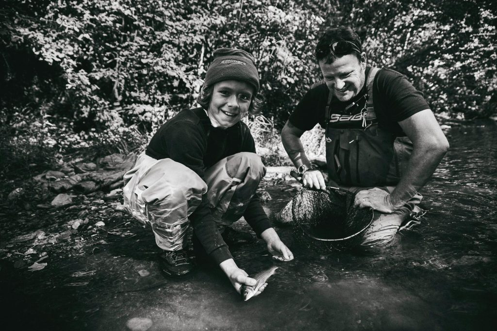 Young fly fishing student with fly fishing tutor